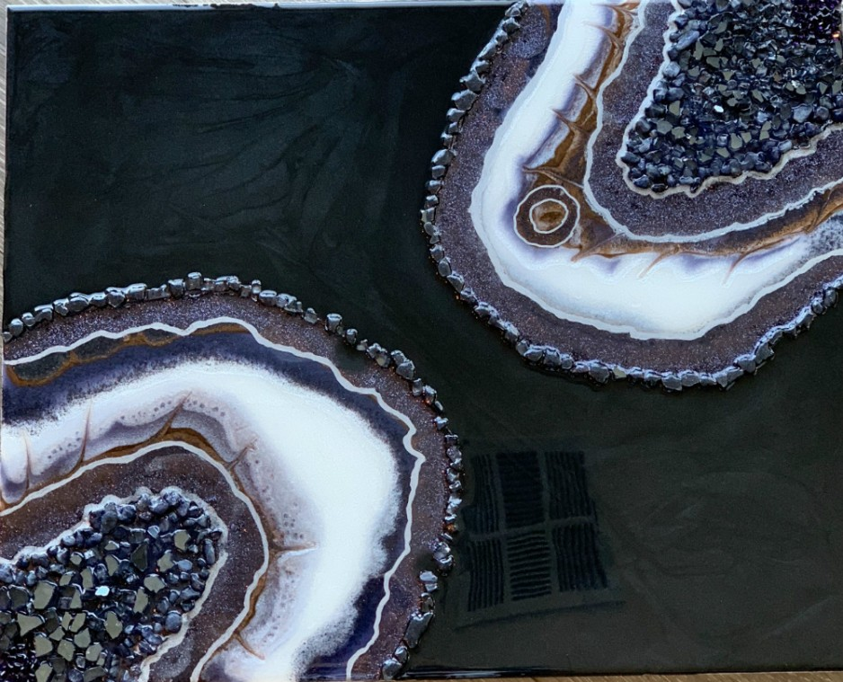 A painting of two rocks with chyrstalline insides, approaching each other like amoeba.