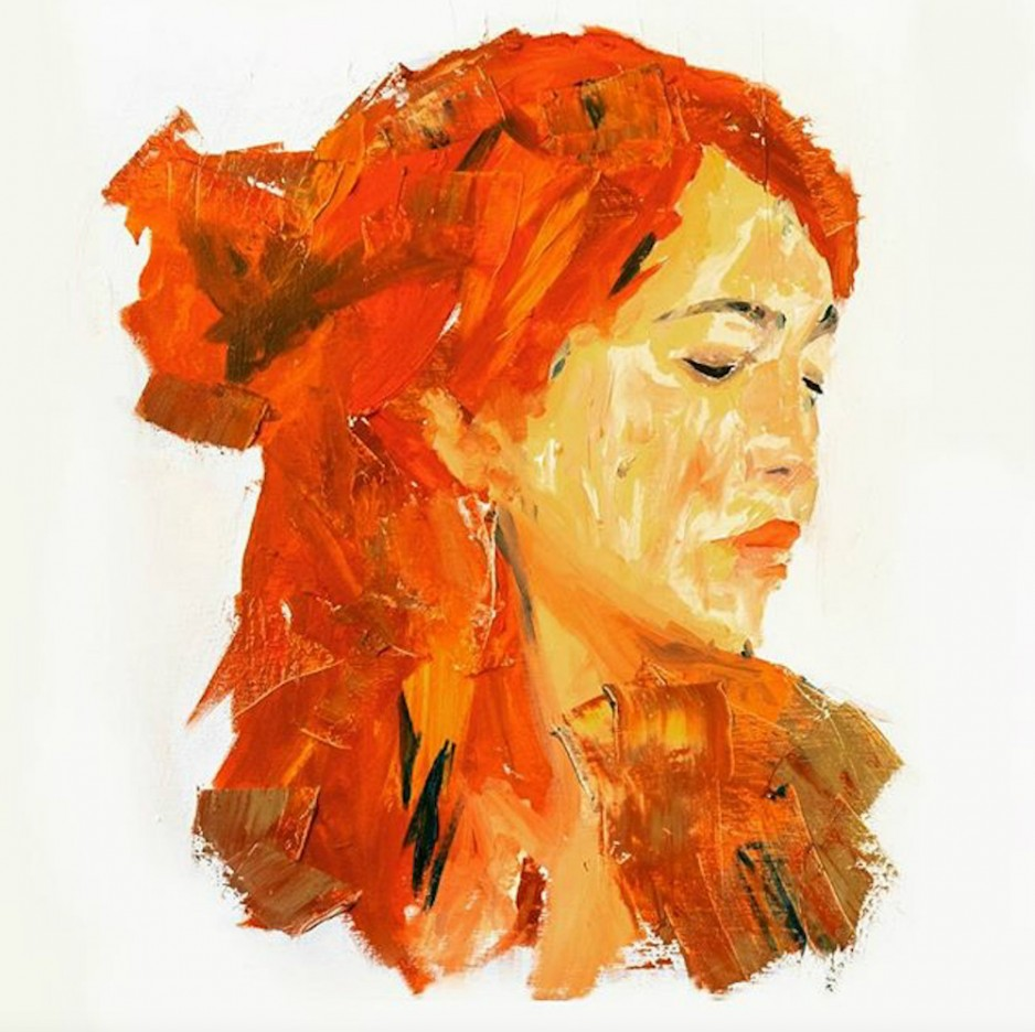 A portrait of a red-headed woman with her eyes shut introspectively.