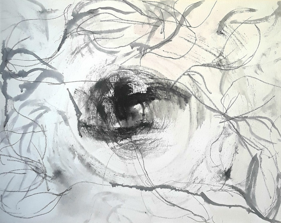 An abstract drawing, black on a white background, squigles with a dark circle in the center.