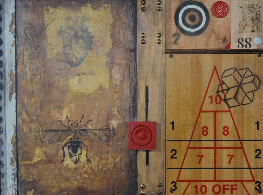 An abstract piece of artwork, consisting of a wooden background with numbers and diagrams written atop.
