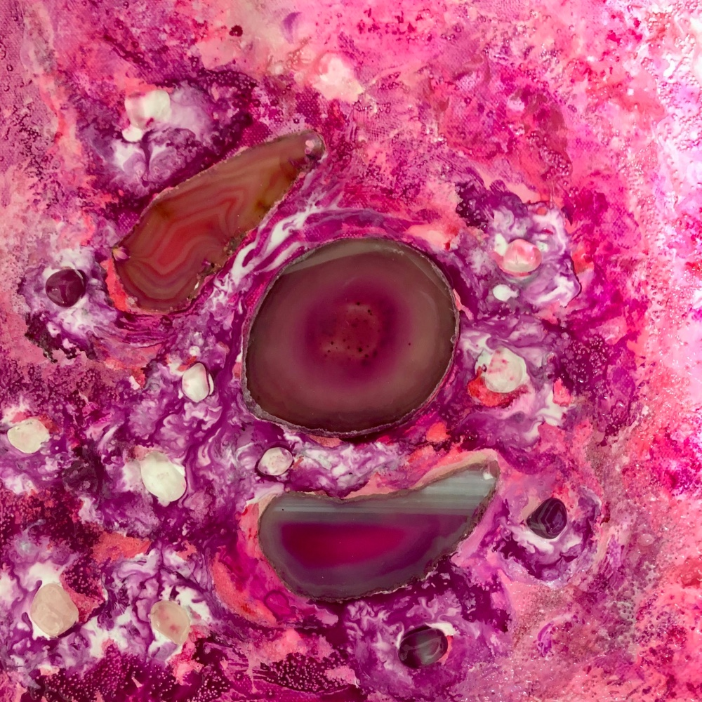 An abstract painting with many shades of pink, resembling three cells in healthy tissue.