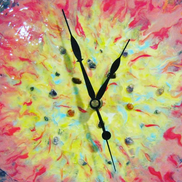 A mixed-medium depiction of a clock.